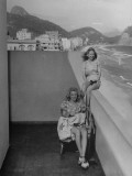 Two Women Sitting on the Balconey of their Apartment Premium Photographic Print by Hart Preston