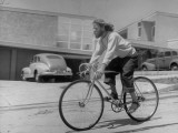Composer Eden Ahbez Enjoying a Bike Ride Premium Photographic Print by Peter Stackpole