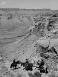 Horsemen Riding Down Shelf of Grand Canyon Premium Photographic Print by John Florea