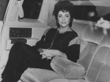 Actress Elizabeth Taylor Sitting in the Back of a Limo Premium Photographic Print by David Mcgough