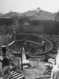 Men Constructing a Pool by Paddock Swimming Pool Company Premium Photographic Print by John Florea