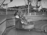 A Couple Enjoying a Ride at the World's Fair in Brazil Premium Photographic Print by Hart Preston