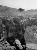 Helicopter Flying over the Grand Canyon Premium Photographic Print by John Florea