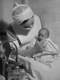 Nurse with Premature Baby Premium Photographic Print by Hansel Mieth