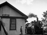 Steam Engine Arriving at Railroad Station Premium Photographic Print by Gordon Coster