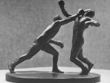 Cecil Howard's Sculpture of Two Men Boxing Premium Photographic Print by Andreas Feininger