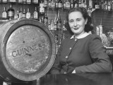 Irish Barmaid at Airport Bar with Keg of Guinness Beer Premium Photographic Print by Nat Farbman