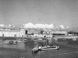 A View Showing Boats Sailing Through the Harbor Premium Photographic Print by Hart Preston