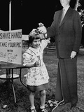 Little Girl Shaking Hands with Cardboard Image of Robert Taft at Carnival to Raise Campaign Funds Photographic Print