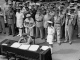 Gen. Douglas Macarthur as Vice Marshal L.M. Isitt Signs Surrender of Japan Aboard USS Missouri Premium Photographic Print