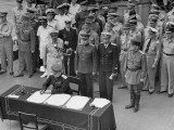 Gen. Douglas Macarthur as Russian Gen. Derevyanko Signs Surrender of Japan Aboard USS Missouri Premium Photographic Print