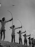 Girls Practicing Archery Photographic Print