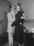Comedian Groucho Marx Embracing a Woman Premium Photographic Print