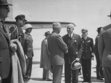 President Harry S. Truman, Shaking Hands with Edward R. Stettinius Jr. at Hamilton Field Premium Photographic Print