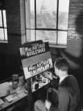 A Man Painting a Macarthur Boulevard Sign in Honor of General Douglas Macarthur Premium Photographic Print