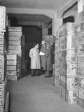 Director of Greek War Relief from Chicago and His Assistant Inspecting the Warehouse Premium Photographic Print