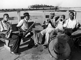 Group of Musicians Playing Along Side the Mississippi River Premium Photographic Print