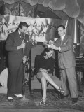 A Man Crowning the Winner of the Revlon Fashion Show Premium Photographic Print