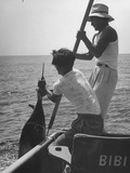 Pulling Quickly, the Beaten Fish Is Taken Aboard the Boat by Gloved Crew Member Photographic Print