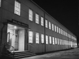 Exterior of the Office of Price Administration Where Employees are Working into the Night Premium Photographic Print