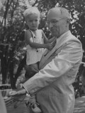President Harry S. Truman Holding a Little Boy During Visit to His Hometown Premium Photographic Print