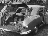 A Man and a Woman Loading Up their Car Premium Photographic Print