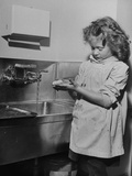 A Little Girl Washing Her Hands Premium Photographic Print