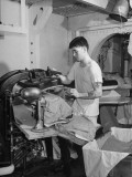 A Sailor Pressing Uniform Trousers in the Tailor Shop of a US Navy Cruiser Premium Photographic Print