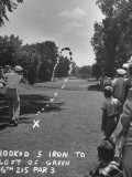 Golfer Byron Nelson Making a Hooked Shot to Left of the 16th Green Reproduction photographique sur papier de qualité