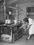 Mrs. Michael Stern Inspecting an Old Fashioned Wooden Kitchen Stove Premium Photographic Print