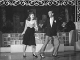 Fred Astaire and Joan Leslie, Dancing and Singing on Stage Together Premium Photographic Print