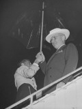 President Harry S. Truman Leaving Airplane in Rainstorm Premium Photographic Print