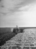 A View of a Driveless Tractor Used on Farm Premium Photographic Print