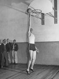 Basketball Player Max Palmer Reaching Up to Drop Basketball into Basket Premium Photographic Print