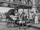 Women in a Rickshaw Passing Evacuees Streaming across the Howrah Bridge Premium Photographic Print