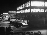 Exterior of Firestone Tire and Rubber Co. Plant at Night Premium Photographic Print