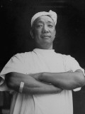 Prof. Henry S. Okasaki Standing with Arms Folded Premium Photographic Print