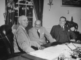 Presiident Harry Truman Sitting in the Oval Office with Lewis B. Schwellenbach Premium Photographic Print