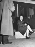 Wrestler Mildred Burke Sitting on Suitcase after Fight, Talking with Fight Advisers Premium Photographic Print