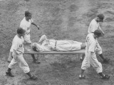 Joe Medwick Being Carried Off Field on Stretcher by Four Players after Being Beaned with Baseball Premium Photographic Print