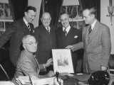 President Harry S. Truman Amd Others Looking at a Picture in the Oval Office Premium Photographic Print