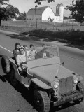 Farmer and Family Riding in a Jeep in Demonstration of Postwar Uses for Military Vehicles Premium Photographic Print