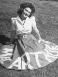 "A Woman Wearing a Skirt That Says ""Macarthur"" in Honor of General Douglas Macarthur Premium Photographic Print"