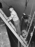 President Harry S. Truman Standing on a Ladder Between a Dock and a Boat Premium Photographic Print