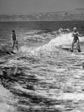 A Boy and a Girl Is Enjoying their Time Water Skiing at Santa Monica Beach Premium Photographic Print
