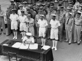 Gen. Douglas MacArthur as British Adm. Fraser Signs Official Surrender of Japan Aboard USS Missouri Premium Photographic Print