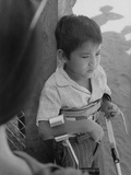 A 10-Year Old Paraplegic Lau Nguyen, Wounded in Vietnam War Premium Photographic Print