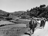 US Marines March Towards the Front Lines During the Fight to Take the Island of Okinawa Premium Photographic Print