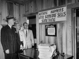 Eastern Airline Representative Eddie Rickenbacker Reading a Sign at His Companies Airport Premium Photographic Print