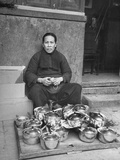 A Cookware Vendor Sitting by Her Wares Premium Photographic Print